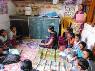 Helping teach children in the slums of Delhi.