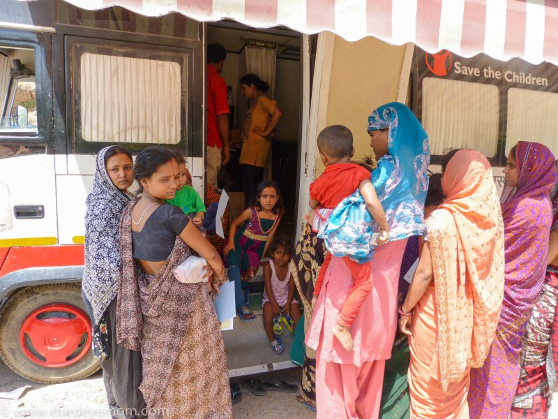 Indians waiting to line at a Mobile Health Unit