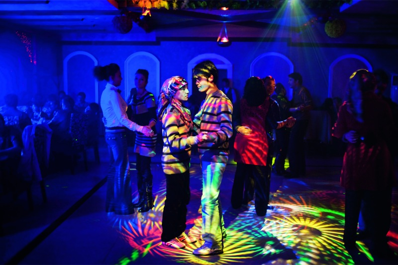 CAROLYN DRAKE In Hotan, a Uygur town with a rising Han Chinese population, Uygurs socialize at their own nightclubs.