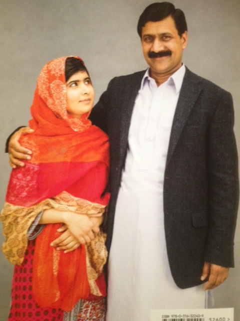"""Photo of Malala and her father on the back cover of her new book """"I am Malala""""."""