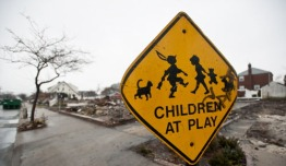 A street sign among the burnt out homes in the after math of Superstorm Sandy Photo credit: Save the Children
