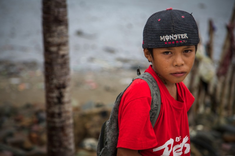 James, 11, stands on the floor of what once was his school, the primary school in Binon-an, Batad, Iloilo province, Panay Island. Photo credit: Hedinn Halldorsson/Save the Children