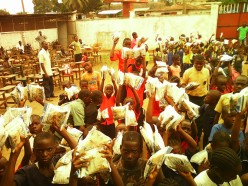 Children waiting in line to get food and supplies. Photo credit: New Vision