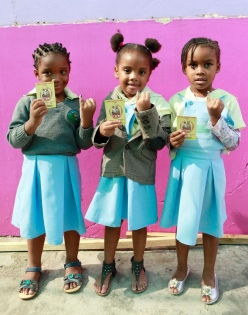 Young girls in Mozambique show off their newly updated vaccination card.  All photos : Shot@Life--UN Foundation, Mozambique, Wednesday, June 1, 2011 (Photo/Stuart Ramson)