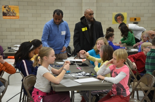 5th Graders at L'Etoile du Nord, a French Immersion school in St. Paul Public School system, volunteer to make lights for the children in Ethiopia