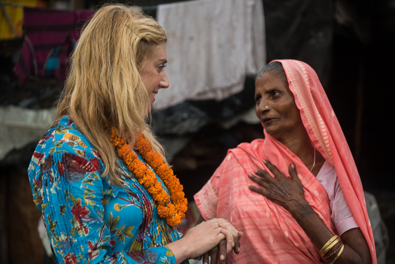 This is taken in We are in the slums of Dehra Dun, India and shows Jane talking with a mother of a polio survivor.  Her son, the polio survivor, is able to work, allowing the family (including the mother pictured) to be supported.  Photo credit: Neil Ruskin