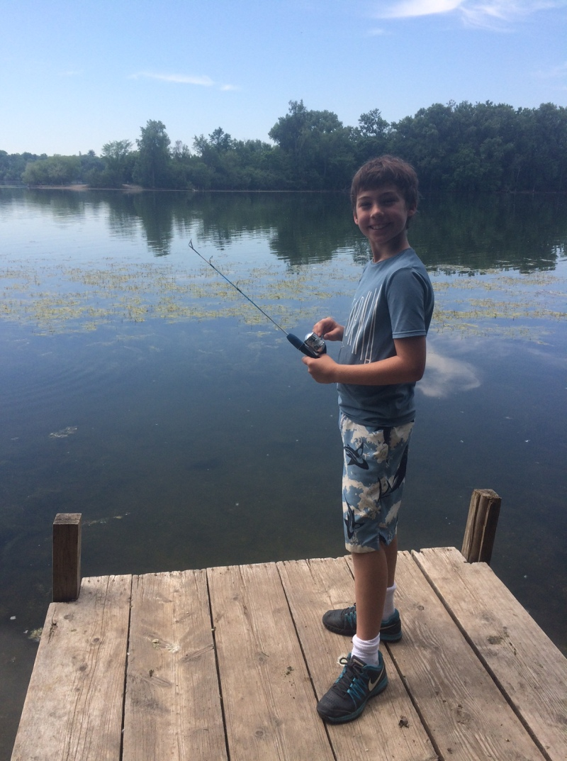 "Meanwhile Max is at a week long ""bike, swim, paddle and fish camp"". He biked 25 miles yesterday!"