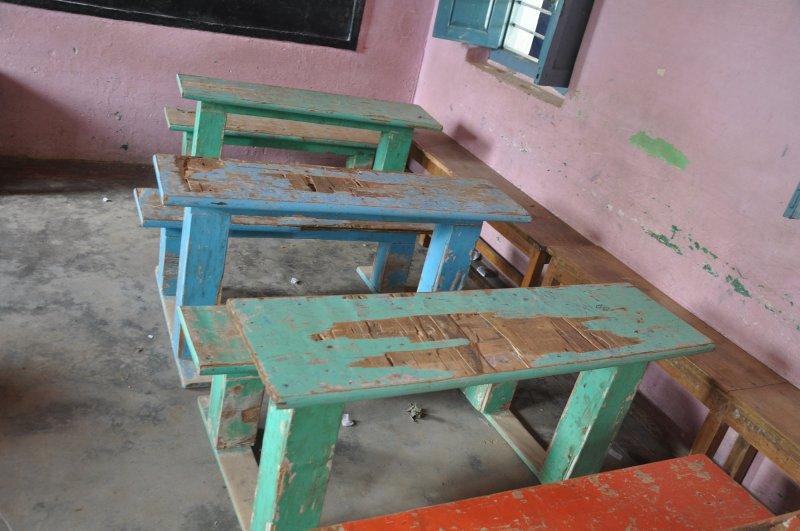 Broken desks at the Mangala school (Photo credit: Austin Thomas)