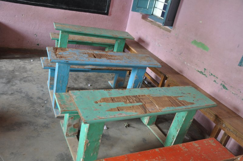 Broken desks at the Mangala school (Photo credit: Austin Thomas)