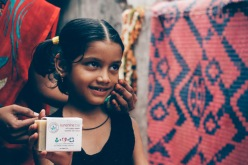 Children from Kalwa slum show their gratitude for b.a.r.e. soaps and Sundara's help in employing local women from their slum